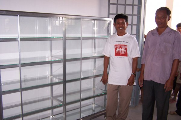 Mr Hon and Mr Onn with the first bookcase