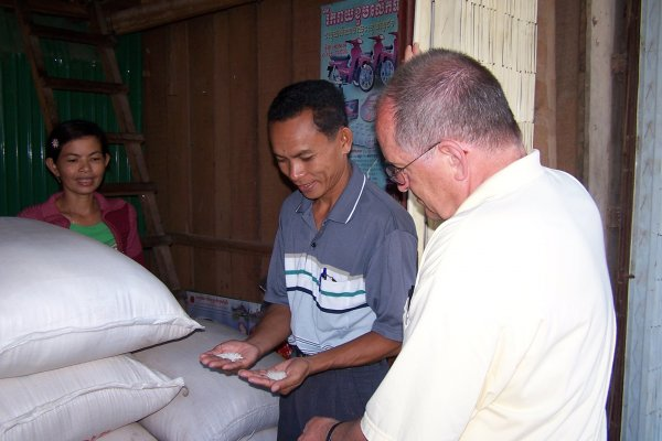 Phath and Martin selecting rice